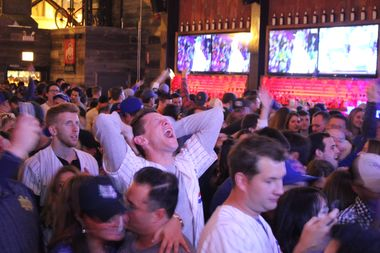 A Cubs fans lets out a exuberant shout as the team gets ever-closer to a World Series.