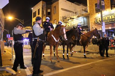Police mounted units stand guard at Clark and Waveland after the Cubs won the National League pennant.