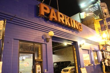 Unfortunately for this auto shop, police blocked off portions of Clark Street early Saturday night, prompting attendants to bump parking prices from $100 to $40.