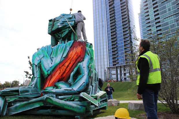 The newest sculpture in Grant Park is a 15-foot-tall wooden Buddha sending a message about deforestation.