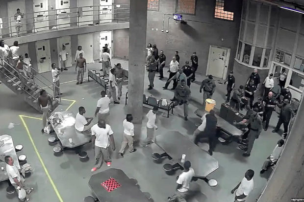 A video released Wednesday shows a brawl at Cook County Jail that sent 10 people — including two correctional officers — to the hospital Tuesday night.