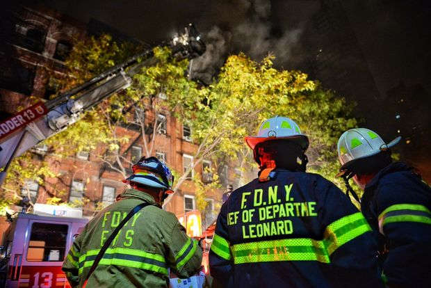A man was found dead and 13 others were injured in the fire, officials said.