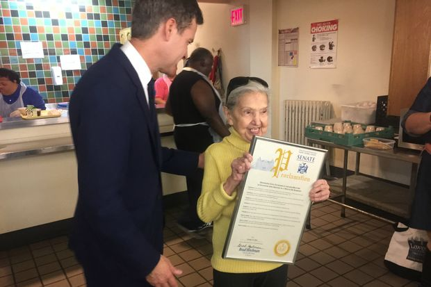 Gina Zuckerman, 90, receives a proclamation for bravery and volunteerism from State Senator Brad Hoylman.