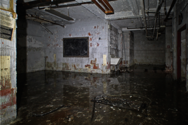 The city allowed the basement of the defunct Greenpoint Hospital Nurses' dormitory to flood for two years before capping the leaking pipe.