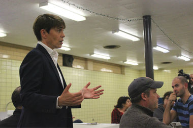 The controversial Manor diverter will come down Friday, Ald. Deb Mell told residents Thursday night.