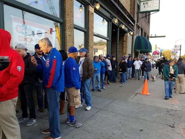 People lined up outside the Cubby Bear at 7 a.m. Friday to watch the game, which starts in 12 hours.