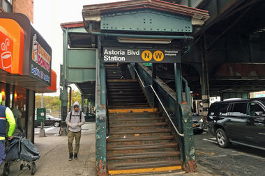 The Astoria Boulevard station with new signs for the W train.