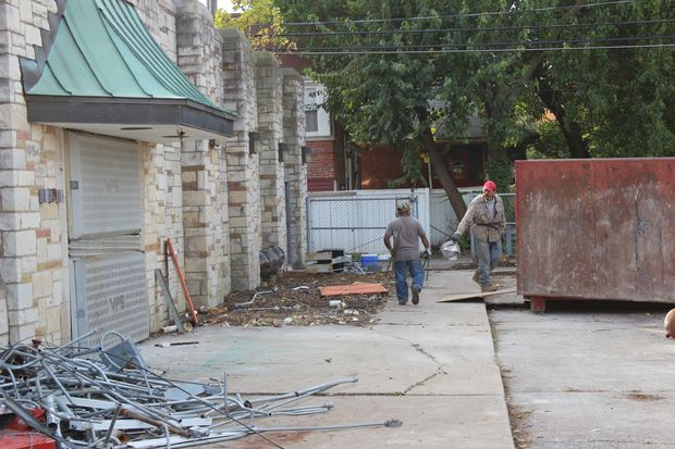 Demolition crews clear out a building Friday at 2105 W. 95th St. in Beverly. This building will serve as a catering kitchen for Barraco's Pizza as well as provide food for a banquet hall called