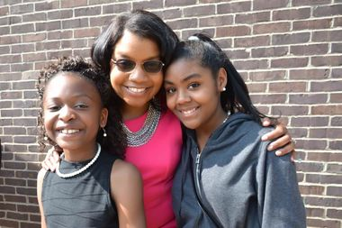 Jamila Trimuel, founder and executive director of Ladies of Virtue, poses with two students. The nonprofit will host a fundraiser to expand into more schools.