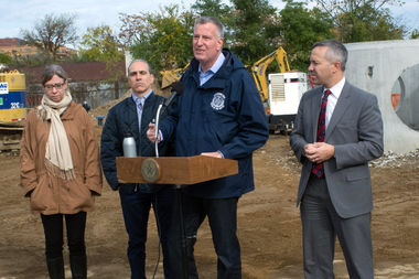 Mayor Bill de Blaise on Saturday marked the fourth anniversary of Hurricane Sandy in Staten Island taking questions on Build It Back. De Blasio said the program's delay was due in part to homeowners' expectations.