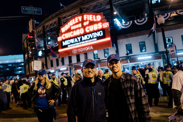 Justin Escalona with his dad at Wrigley Field for Game 3 of the World Series.