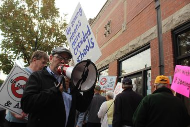 Jefferson Park Neighborhood Association president Robert Bank led a protest Saturday against changing zoning regulations to allow more development.