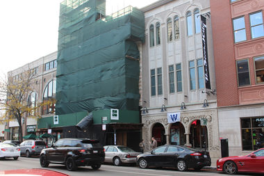 The facade of the former Adobo Grill building at 1610 N. Wells St. remains covered by a tarp pending a proposed demolition being fought by preservationists.