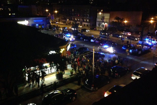 Teens and police seen Monday night near 53rd Street and Dorchester Avenue during a mass gathering of teens in Hyde Park.