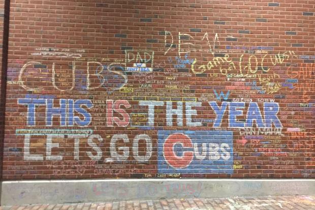 Scrawling chalk messages of support for the Chicago Cubs stretched along Wrigley Field on the sides facing Sheffield and Waveland avenues as the Cubs wrapped up the World Series.