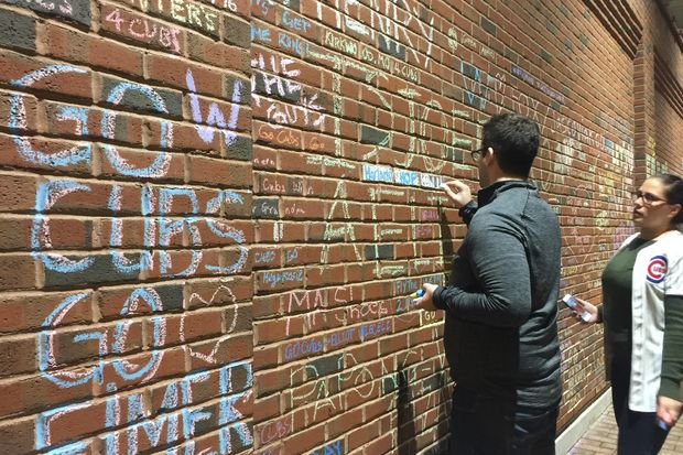 Christopher Cummings (left) Embellishes The Message His Wife, Rebecca  Conner, Dedicated To Her Grandfather On The Wrigley Field Wall Facing  Waveland Avenue ...