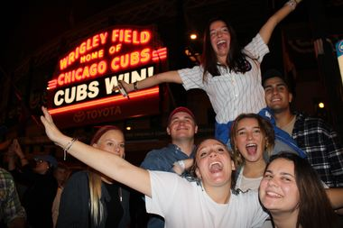 Cubs fans celebrate the Game 6 win in the World Series outside Wrigley Field.
