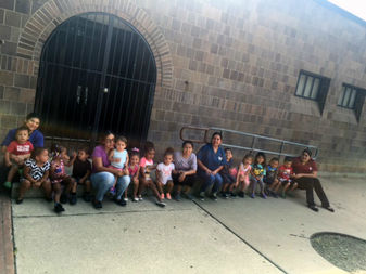 Kids sitting in front of Von Humboldt's annex, 1345 N. Rockwell St., which will become a daycare center under the plan.