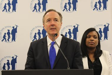 Chicago Public Schools CEO Forrest Claypool discusses the new contract agreement with reporters as CPS Chief Education Officer Janice Jackson looks on Wednesday.