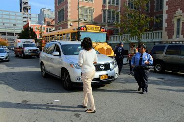 A student and woman were struck by a car outside P.S. 373 on Wednesday afternoon, officials and witnesses said.