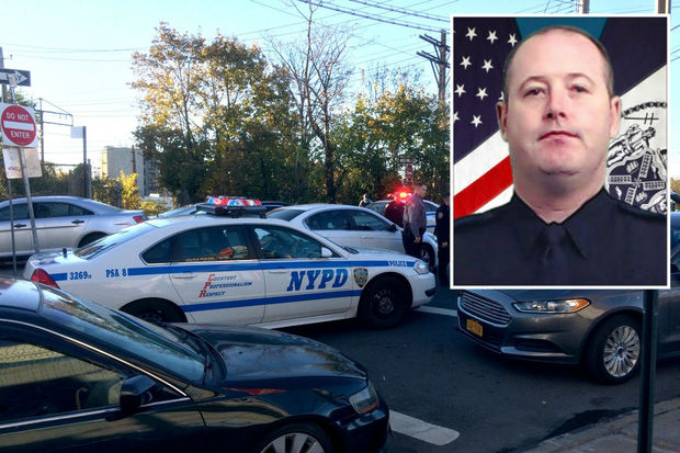 A veteranNYPD sergeant, Paul Tuozzolo, was fatally shot in the head and his partner wounded during a gun battle with a heavily armed man in  Van Nest Friday afternoon, officials said.