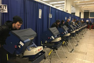 Voters cast their ballots Monday at 15 W. Washington St.