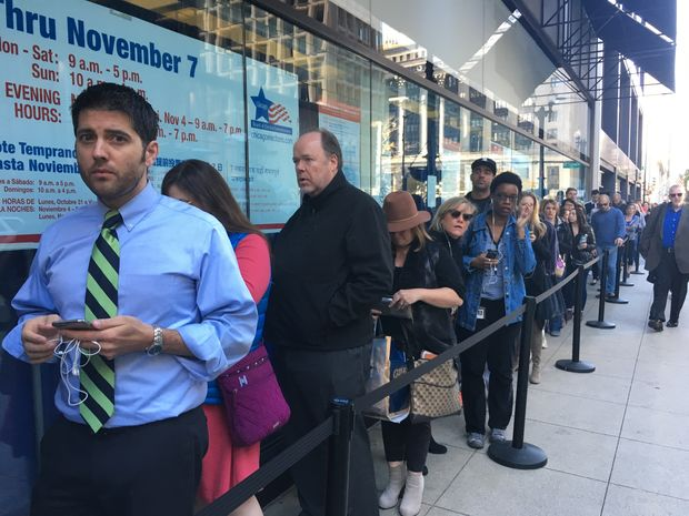Voters lined up outside the early voting super site at 15 W. Washington Monday.