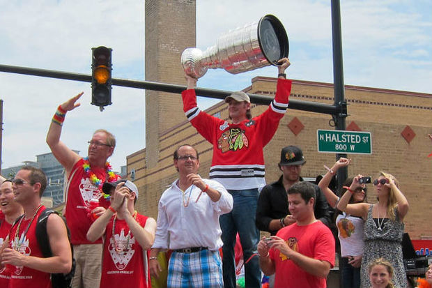 Brent Sopel raises the Stanley Cup at Chicago's Pride Parade in 2010.