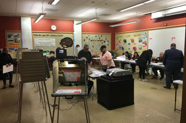 Voters log their choices for the 2016 election at the Chicago Public Library in Little Village.
