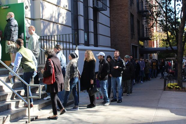 Voters waited in line between one and two hours Tuesday morning outside the Yorkville Community School.