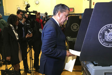 Adriano Espaillat casts his vote to take over outgoing Rep. Charles Rangel's 13th Congressional District seat, Nov. 8, 2016.