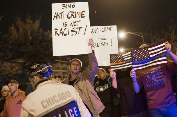 A group showing support for police officers held signs Tuesday night and chanted,