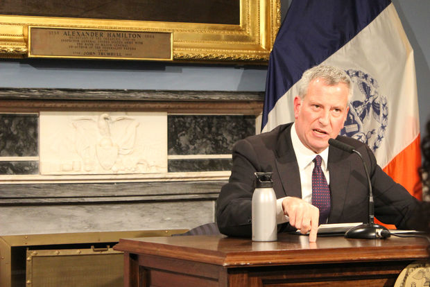 Mayor Bill de Blasio said New York City will protect its population of undocumented immigrants from the federal government if necessary following Donald Trump's election as president, vowing not to turn over data from its IDNYC program.
