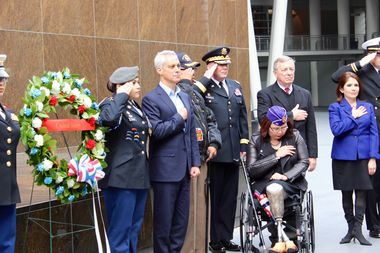 Mayor Rahm Emanuel, Senator-elect Tammy Duckworth, and Sen. Dick Durbin lay a wreath for veterans Friday at Soldier Field.