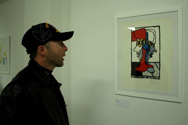 The exhibit includes 36 prints by the author, depicting his struggle to return to society after war.