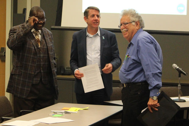 Allan Mellis (right) talks with CTA Board members the Rev. Johnny Miller and Kevin Irvine before Monday's budget hearing.