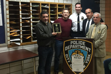 Malibu Diner owners José Collado and Alexandros Grimpas accept a plaque from Lieutenant Bekim Kalicovic, Detective Ray Dorian, and 13th Precinct Community Council President Frank Scala.