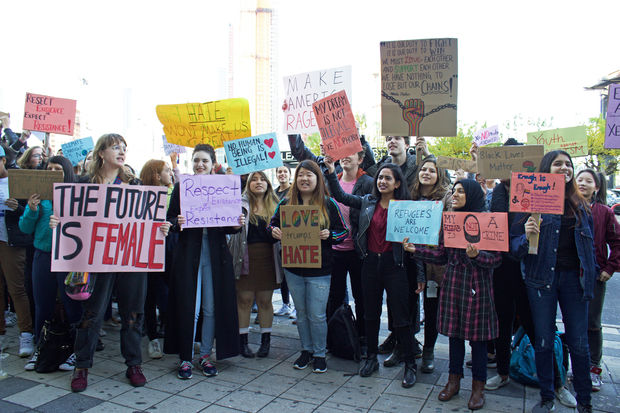 Dozens of students walked out of class at Bard High School Early College in Queens on Wednesday, chanting and holding signs to protest President-Elect Donald Trump.