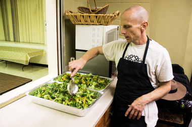 Daiken Nelson prepares food at Harlem's All Souls' Episcopal Church, which is a part of a six-week program he runs to help the unemployed gain culinary skills.