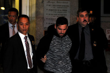 Lawrence Dilione, 28, was walked out of the 13th Precinct in Gramercy on Thursday after being arrested in connection with the murder of Joseph Comunale.