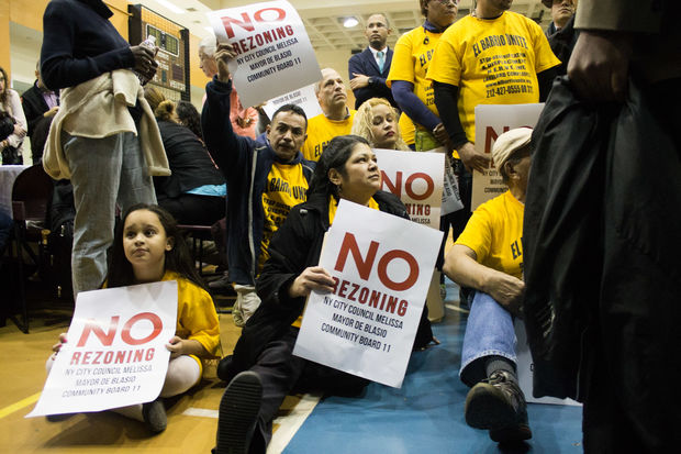 Residents protest at the East Harlem rezoning forum.