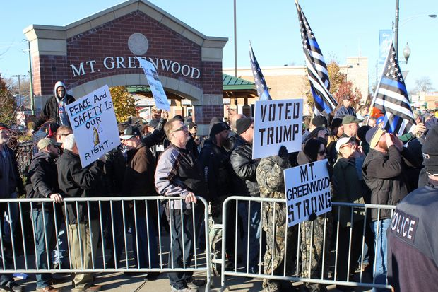 A counter protest was mostly contained to the northwest corner of 111th Street and Kedzie Avenue in Mount Greenwood. The group organized under the thin blue line flags was smaller in number than what was seen at two previous protests.