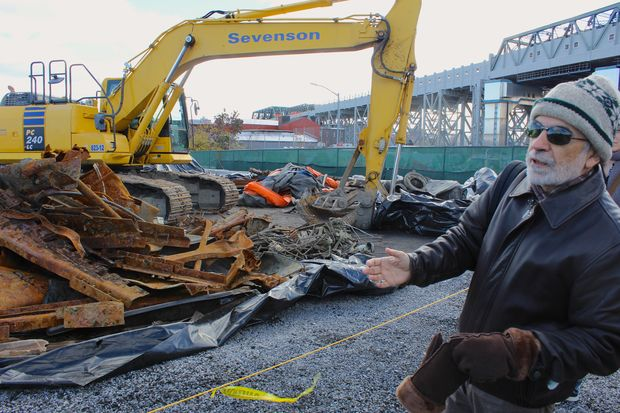 EPA's remediation project manager Christos Tsiamis showing visitors debris that was recently pulled from the Gowanus Canal.