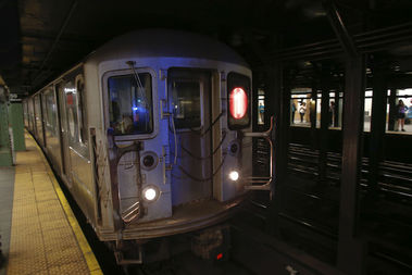 """A train conductor found swastikas and """"offensive"""" messages scrawled on the walls and door of a 1 train car, the NYPD said."""