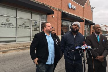 Activists visit the office of Rep. Elgie Sims (D-Chicago) to demand passage of the