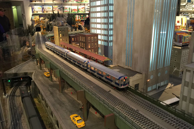 The New York City Transit Museum's annual model train exhibit is up and running at the museum's Grand Central Terminal annex, with numerous trains, subway lines, and streetcars chugging along tracks that run through an ornate landscape between Grand Central and the North Pole.