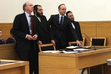 The Israel brothers remained somber as they plead guilty to four charges Tuesday. (From left to right: Attorney Kevin Keating, Joel Israel, John Carman and his client Amrom Israel)