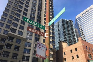 The sign honoring President-elect Donald Trump  outside Trump Plaza at Wabash Avenue and Hubbard Street has been removed.