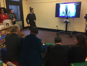 City officials participate in a demonstration of the video chat system for inmates and families at the East Harlem 125th Street Branch of the New York Public Library system.