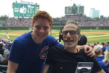 Griffen Saul and his father, Brad Saul, attend a Cub game at Wrigley Field.